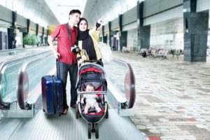 family at airport with baby