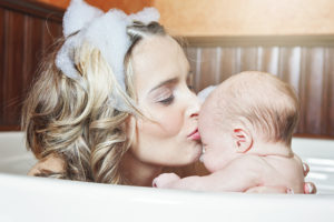 mom having bath with baby